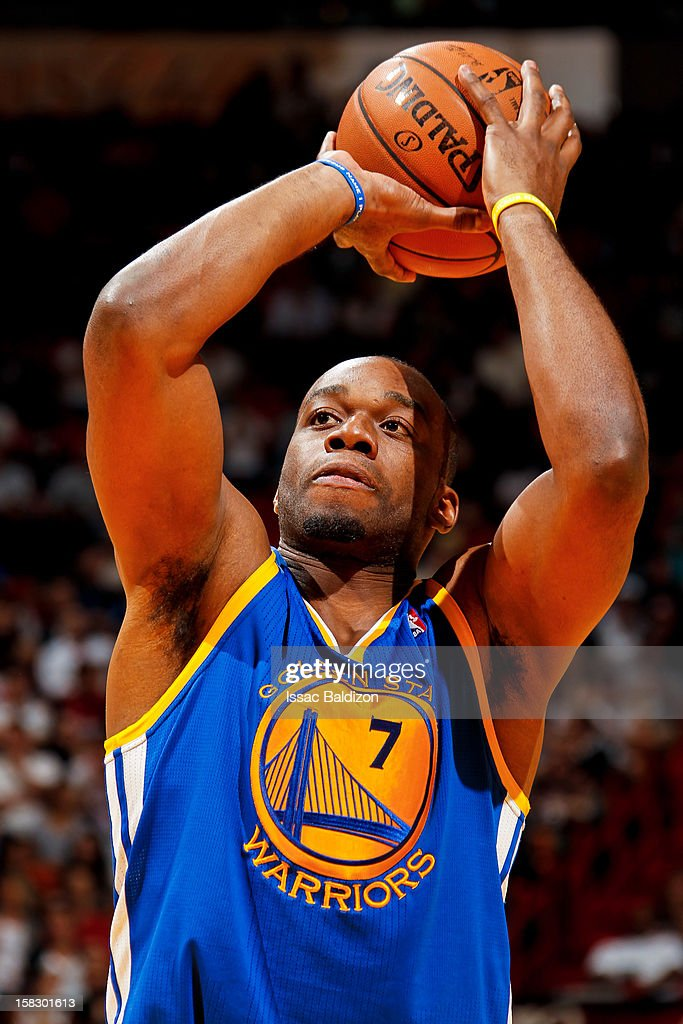 Carl Landry #7 of the Golden State Warriors shoots a free-throw against the Miami Heat on December 12, 2012 at American Airlines Arena in Miami, Florida.