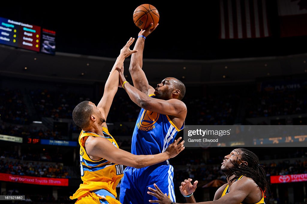 Carl Landry #7 of the Golden State Warriors shoots against Anthony Randolph #15 of the Denver Nuggets in Game Two of the Western Conference Quarterfinals during the 2013 NBA Playoffs on April 23, 2013 at the Pepsi Center in Denver, Colorado.