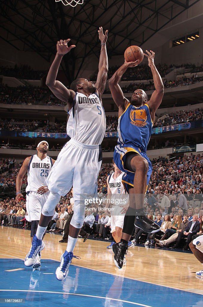 Carl Landry #7 of the Golden State Warriors shoots against Bernard James #5 of the Dallas Mavericks on November 19, 2012 at the American Airlines Center in Dallas, Texas.