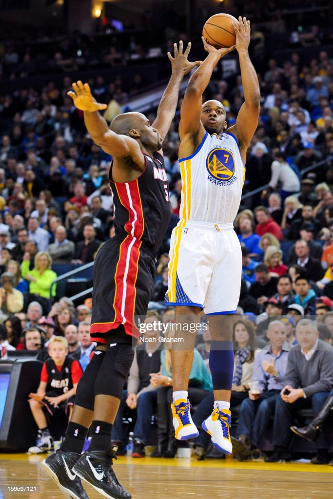 Carl Landry #7 of the Golden State Warriors shoots against Joel Anthony #50 of the Miami Heat on January 16, 2013 at Oracle Arena in Oakland, California.