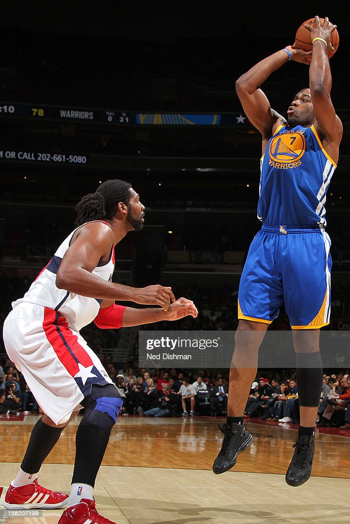 <a gi-track='captionPersonalityLinkClicked' href=/galleries/search?phrase=Carl+Landry&family=editorial&specificpeople=4111952 ng-click='$event.stopPropagation()'>Carl Landry</a> #7 of the Golden State Warriors shoots against Nene #42 of the Washington Wizards on December 8, 2012 at the Verizon Center in Washington, DC.