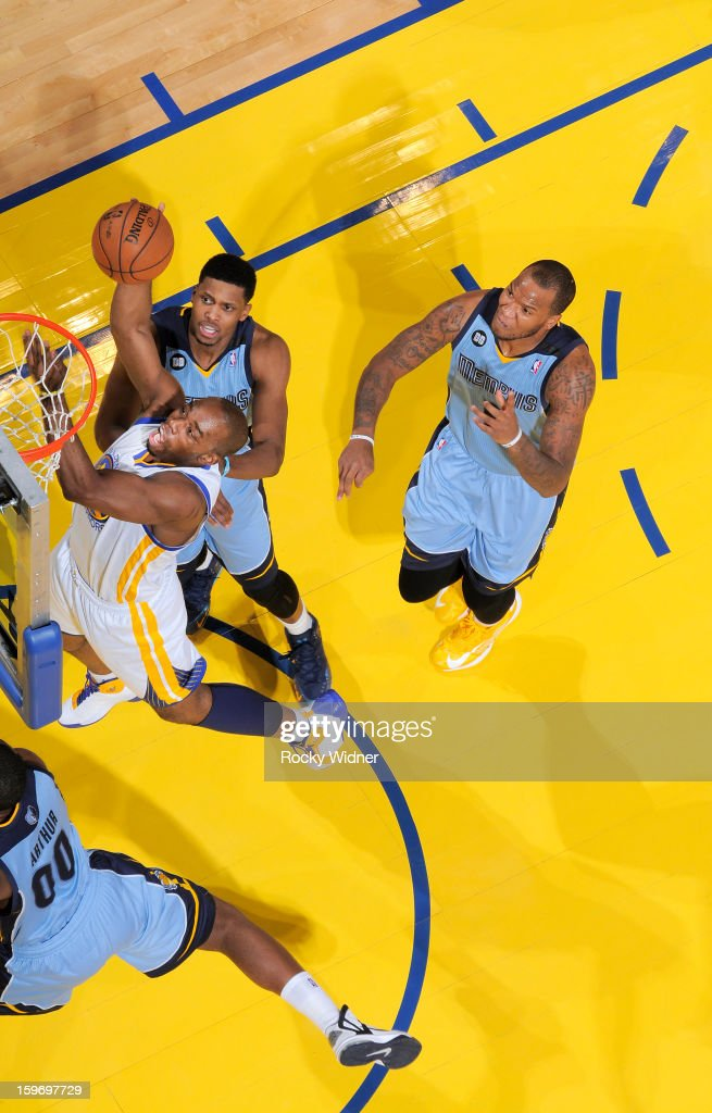 <a gi-track='captionPersonalityLinkClicked' href=/galleries/search?phrase=Carl+Landry&family=editorial&specificpeople=4111952 ng-click='$event.stopPropagation()'>Carl Landry</a> #7 of the Golden State Warriors shoots against <a gi-track='captionPersonalityLinkClicked' href=/galleries/search?phrase=Rudy+Gay&family=editorial&specificpeople=236066 ng-click='$event.stopPropagation()'>Rudy Gay</a> #22 and <a gi-track='captionPersonalityLinkClicked' href=/galleries/search?phrase=Marreese+Speights&family=editorial&specificpeople=4187263 ng-click='$event.stopPropagation()'>Marreese Speights</a> #5 of the Memphis Grizzlies on January 9, 2013 at Oracle Arena in Oakland, California.