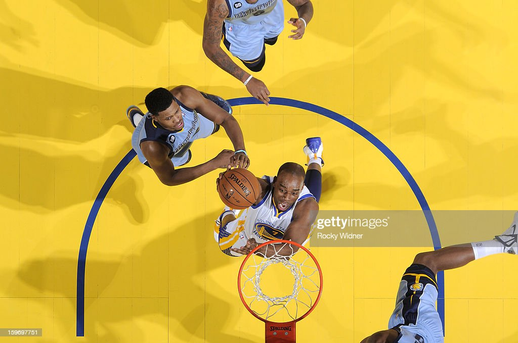 <a gi-track='captionPersonalityLinkClicked' href=/galleries/search?phrase=Carl+Landry&family=editorial&specificpeople=4111952 ng-click='$event.stopPropagation()'>Carl Landry</a> #7 of the Golden State Warriors shoots against <a gi-track='captionPersonalityLinkClicked' href=/galleries/search?phrase=Rudy+Gay&family=editorial&specificpeople=236066 ng-click='$event.stopPropagation()'>Rudy Gay</a> #22 of the Memphis Grizzlies on January 9, 2013 at Oracle Arena in Oakland, California.