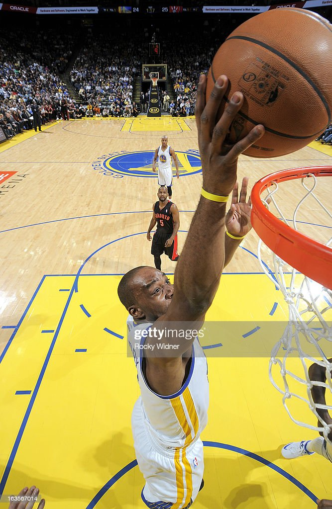 <a gi-track='captionPersonalityLinkClicked' href=/galleries/search?phrase=Carl+Landry&family=editorial&specificpeople=4111952 ng-click='$event.stopPropagation()'>Carl Landry</a> #7 of the Golden State Warriors shoots against the Toronto Raptors on March 4, 2013 at Oracle Arena in Oakland, California.