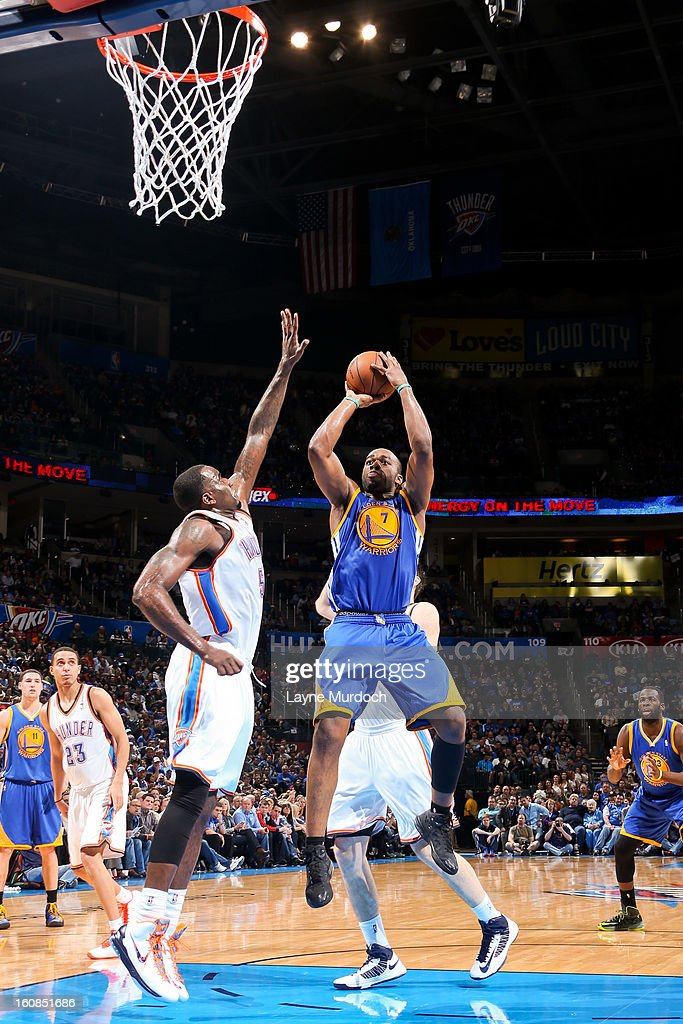 <a gi-track='captionPersonalityLinkClicked' href=/galleries/search?phrase=Carl+Landry&family=editorial&specificpeople=4111952 ng-click='$event.stopPropagation()'>Carl Landry</a> #7 of the Golden State Warriors shoots in the lane against <a gi-track='captionPersonalityLinkClicked' href=/galleries/search?phrase=Kendrick+Perkins&family=editorial&specificpeople=211461 ng-click='$event.stopPropagation()'>Kendrick Perkins</a> #5 of the Oklahoma City Thunder on February 6, 2013 at the Chesapeake Energy Arena in Oklahoma City, Oklahoma.