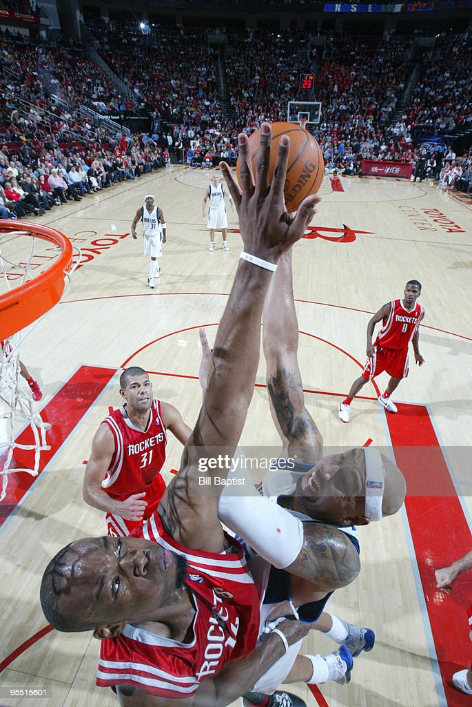 Carl Landry of the Houston Rockets blocks Erick Dampier of the Dallas Mavericks on December 31 2009 at the Toyota Center in Houston Texas NOTE TO...