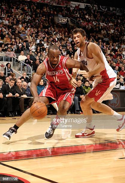 Carl Landry of the Houston Rockets drives against Andrea Bargnani of the Toronto Raptors during the game on December 13 2009 at Air Canada Centre in...