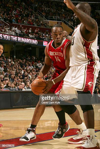 Carl Landry of the Houston Rockets drives into the paint against Shaquille O'Neal of the Cleveland Cavaliers on December 27 2009 at The Quicken Loans...