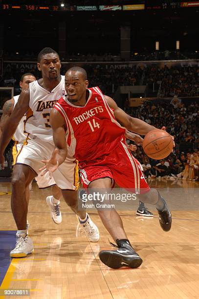 Carl Landry of the Houston Rockets drives past Ron Artest of the Los Angeles Lakers at Staples Center on November 15 2009 in Los Angeles California...