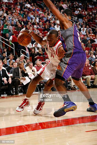 Carl Landry of the Houston Rockets drives the ball past Channing Frye of the Phoenix Suns on November 17 2009 at the Toyota Center in Houston Texas...