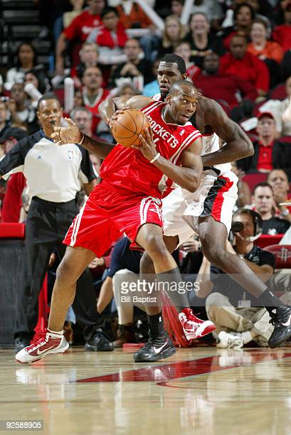 Carl Landry of the Houston Rockets drives the ball past Greg Oden of the Portland Trail Blazers on October 31 2009 at the Toyota Center in Houston...