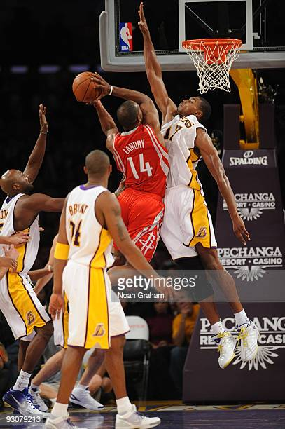 Carl Landry of the Houston Rockets goes up for a shot against Andrew Bynum of the Los Angeles Lakers at Staples Center on November 15 2009 in Los...