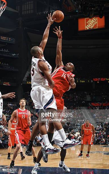Carl Landry of the Houston Rockets puts up a shot against Al Horford of the Atlanta Hawks on November 20 2009 at Philips Arena in Atlanta Georgia...