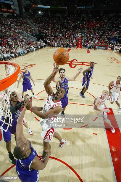 Carl Landry of the Houston Rockets puts up a shot against Kenny Thomas of the Sacramento Kings during the game on November 21 2009 at the Toyota...
