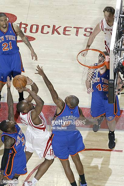 Carl Landry of the Houston Rockets puts up a shot against Nate Robinson and Jonathan Bender of the New York Knicks during the game on January 9 2010...