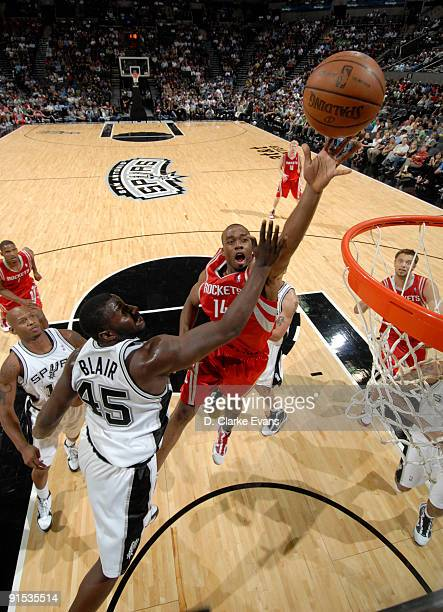 Carl Landry of the Houston Rockets shoots over DeJuan Blair of the San Antonio Spurs on October 6 2009 at the ATT Center in San Antonio Texas NOTE TO...