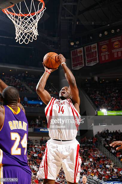 Carl Landry of the Houston Rockets shoots the ball over Kobe Bryant of the Los Angeles Lakers on November 4 2009 at the Toyota Center in Houston...