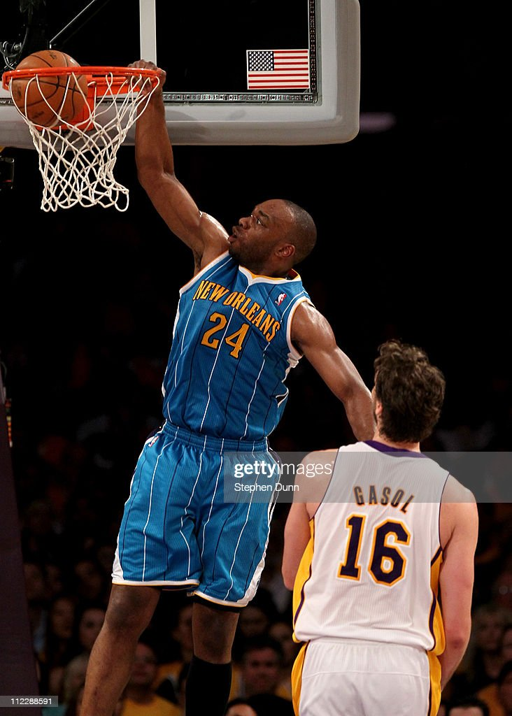 Carl Landry of the New Orleans Hornets dunks over Pau Gasol of the Los Angeles Lakers in Game One of the Western Conference Quarterfinals in the 2011...