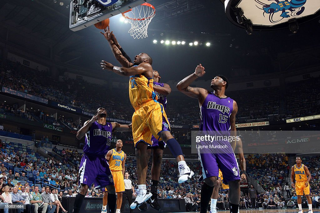Carl Landry of the New Orleans Hornets shoots against Jason Thompson of the Sacramento Kings on March 12 2011 at the New Orleans Arena in New Orleans...