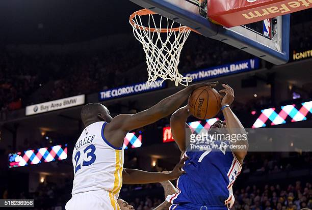 Carl Landry of the Philadelphia 76ers has his shot blocked by Draymond Green of the Golden State Warriors during an NBA Basketball game at ORACLE...