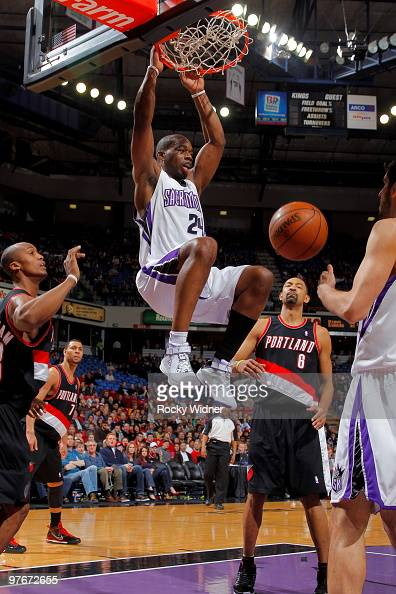 Carl Landry of the Sacramento Kings dunks the ball in front of Juwan Howard of the Portland Trail Blazers on March 12 2010 at ARCO Arena in...