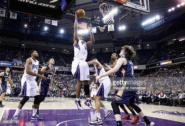 Carl Landry of the Sacramento Kings goes up to shoot against the New Orleans Pelicans at Sleep Train Arena on November 18 2014 in Sacramento...