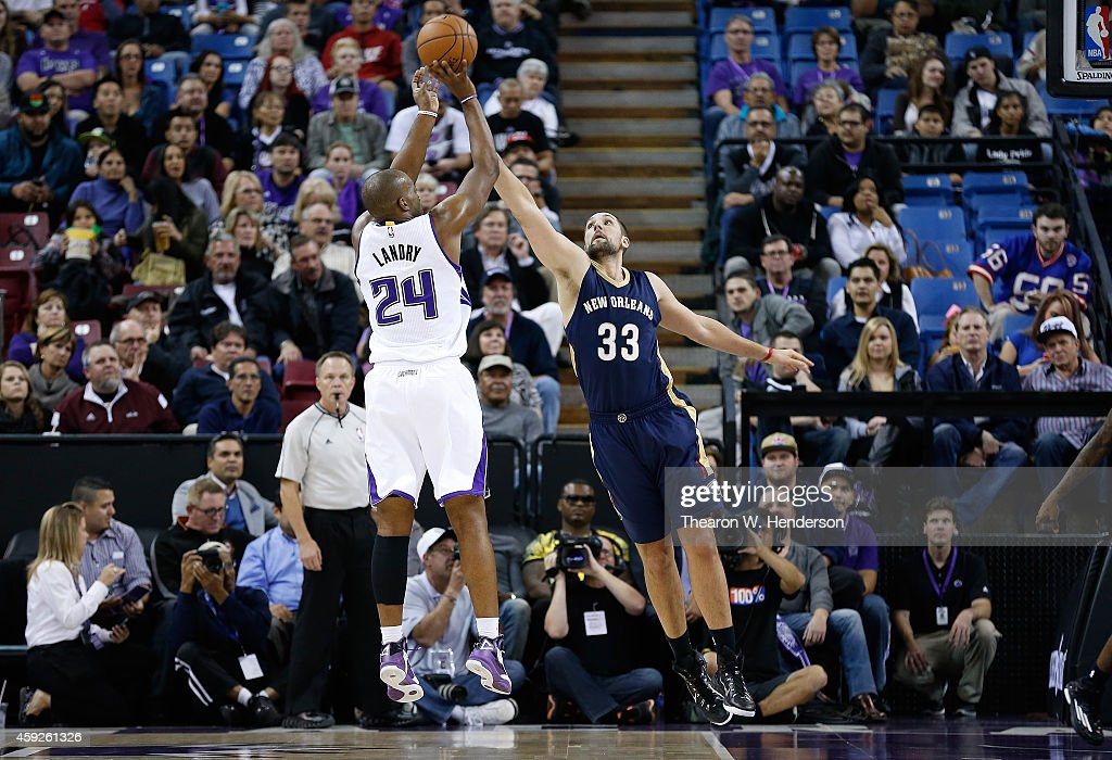 Carl Landry of the Sacramento Kings shoots over Ryan Anderson of the New Orleans Pelicans at Sleep Train Arena on November 18 2014 in Sacramento...