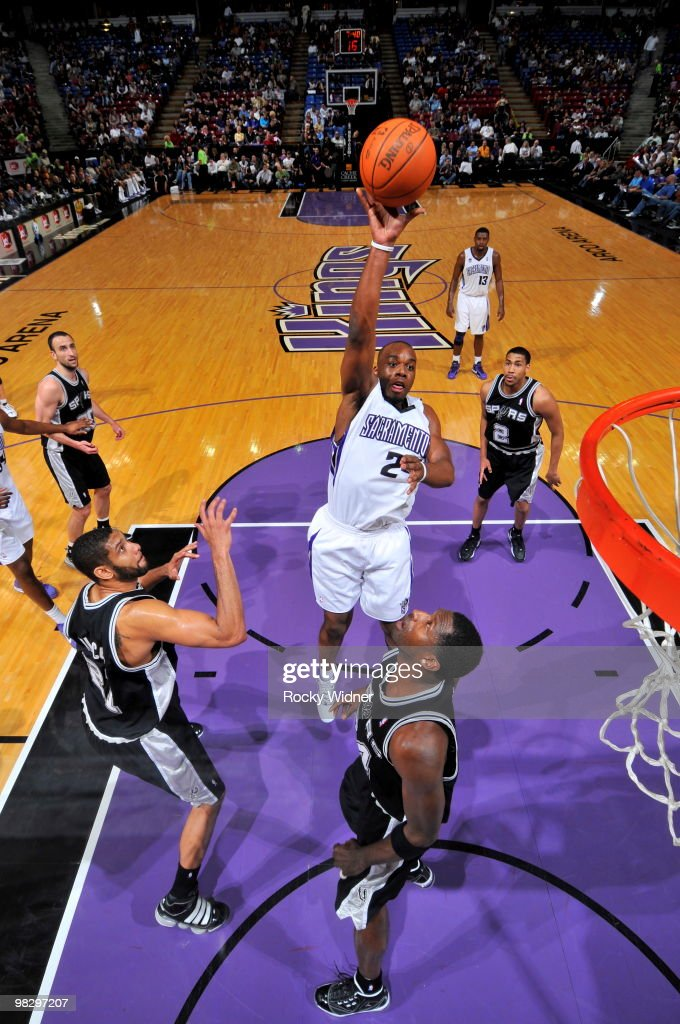 Carl Landry of the Sacramento Kings shoots the ball over Antonio McDyess of the San Antonio Spurs on April 6 2010 at ARCO Arena in Sacramento...