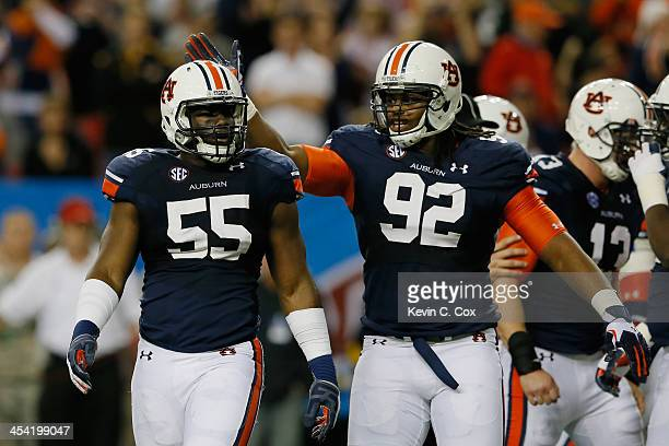 Carl Lawson of the Auburn Tigers celebrates a sack with teammate Kenneth Carter in the second quarter against the Missouri Tigers during the SEC...