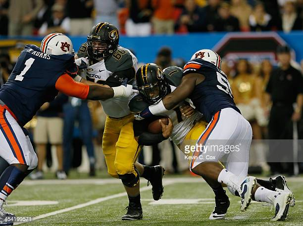 Carl Lawson of the Auburn Tigers tackles quarterback James Franklin of the Missouri Tigers in the second quarter during the SEC Championship Game at...