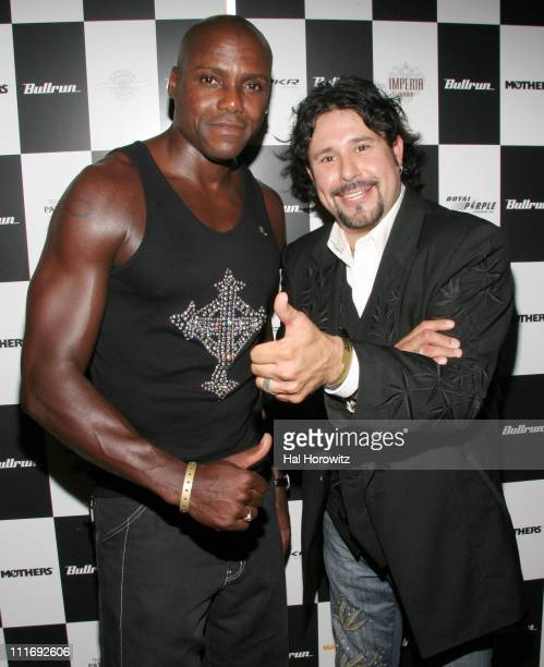 Carl Lewis and Manuel Cuevas designer during Celebration for the Beginning of Bullrun Arrivals July 21 2006 at Marquee in New York City New York...