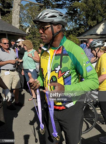 Carl Lewis carries two medals during Best Buddies Challenge Hearst Castle Friendship Races at Hearst Castle on September 7 2013 in San Simeon...