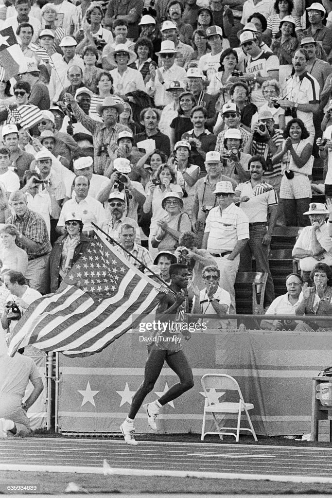 Carl Lewis displays his patriotism and excites the crowd at the 1984 Summer Olympic Games Many communist nations boycotted the Games that year...