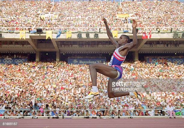 Carl Lewis of the USA flies through the air during the finals of the Men's Olympic long jump competition Barcelona 06 August 1992 Lewis won the gold...