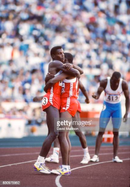 Carl Lewis of the USA hugs teammate Joe DeLoach of the USA after the final of the Men's 200 meter race of the 1988 Olympic Games held on September 28...
