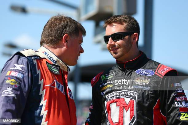 Carl Long driver of the Waltrip Brothers' Charity Championship Chevrolet talks with Matt DiBenedetto driver of the Reddit Ford during the Monster...