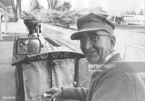 Carl M Carlson at the throttle of his engine the 'Pioneer railroad' in City Park Being a switchman and engine foreman for 50 years with Union Pacific...