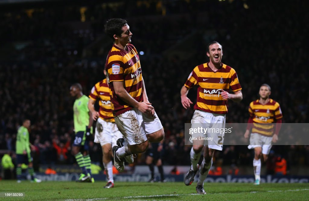 Carl McHugh of Bradford City celebrates after scoring their third goal during the Capital One Cup Semi-Final 1st Leg match between Bradford City and Aston Villa at Coral Windows Stadium, Valley Parade on January 8, 2013 in Bradford, England.