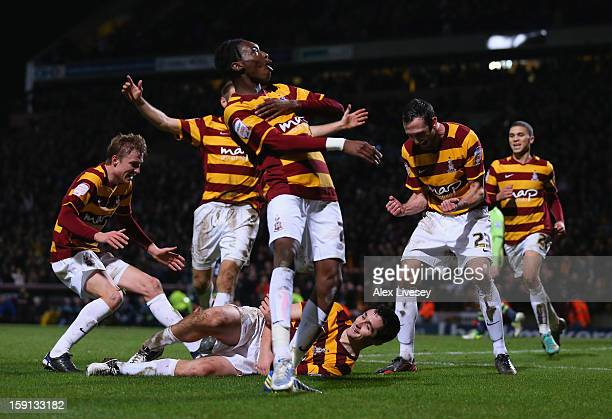 Carl McHugh of Bradford City celebrates with team mates after scoring their third goal during the Capital One Cup SemiFinal 1st Leg match between...