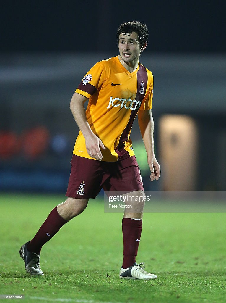 <a gi-track='captionPersonalityLinkClicked' href=/galleries/search?phrase=Carl+McHugh&family=editorial&specificpeople=9932212 ng-click='$event.stopPropagation()'>Carl McHugh</a> of Bradford City in action during the Sky Bet League One match between Coventry City and Bradford City at Sixfields Stadium on April 1, 2014 in Northampton, England.