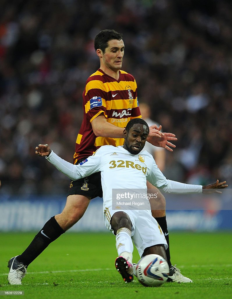 Carl McHugh of Bradford City puts Nathan Dyer of Swansea City under pressure during the Capital One Cup Final match between Bradford City and Swansea City at Wembley Stadium on February 24, 2013 in London, England.