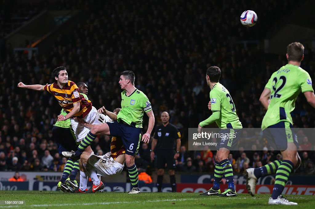 Carl McHugh of Bradford City scores their third goal during the Capital One Cup Semi-Final 1st Leg match between Bradford City and Aston Villa at Coral Windows Stadium, Valley Parade on January 8, 2013 in Bradford, England.