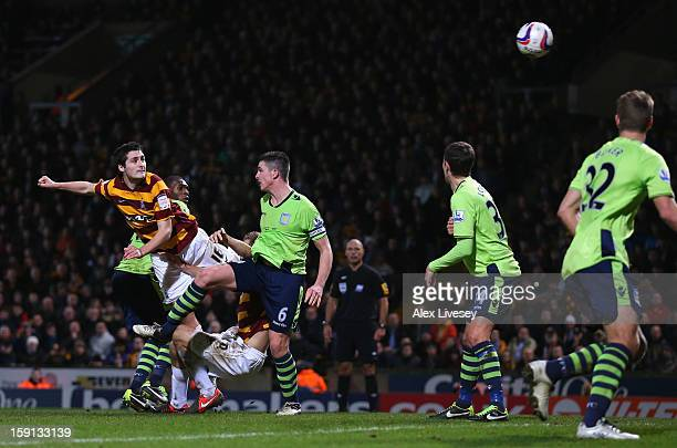 Carl McHugh of Bradford City scores their third goal during the Capital One Cup SemiFinal 1st Leg match between Bradford City and Aston Villa at...