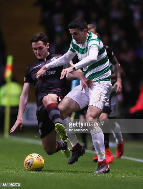 Carl McHugh of Motherwell vies with Tomas Rogic of Celtic during the Ladbrokes Scottish Premiership match between Celtic and Motherwell at Celtic...