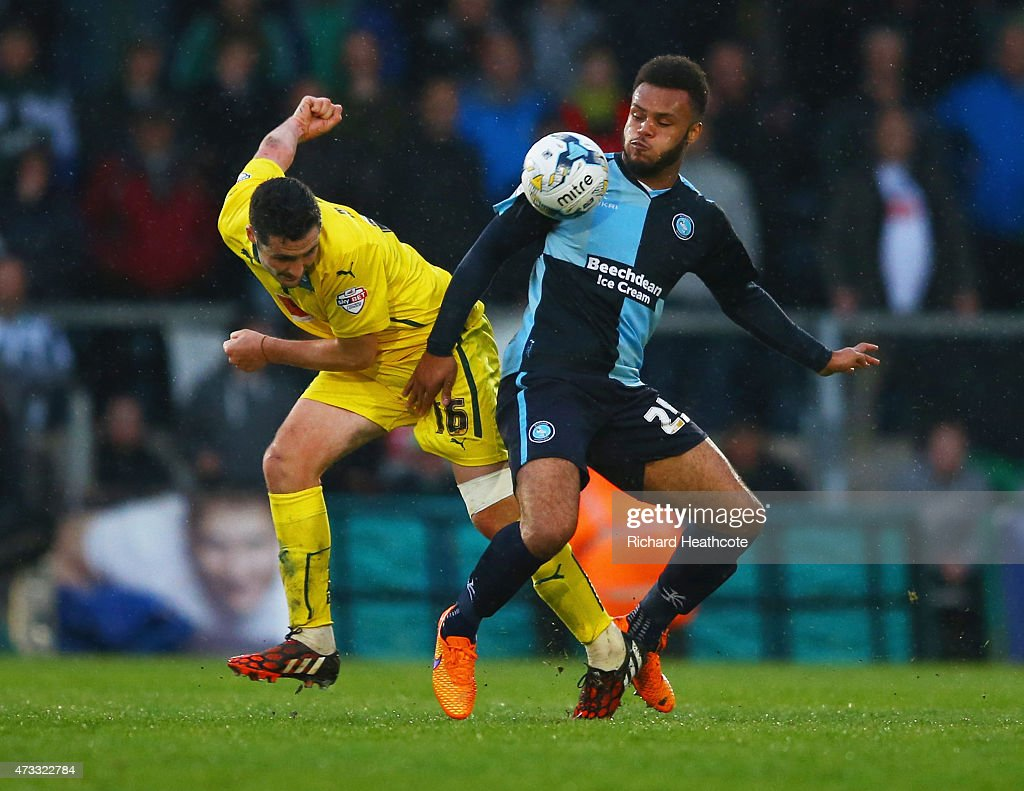 Carl McHugh of Plymouth Argyle and Aaron Holloway of Wycombe Wanderers battle for the ball during the Sky Bet League Two Playoff semi final match between Wycombe Wanderers and Plymouth Argyle at Adams Park on May 14, 2015 in High Wycombe, England.