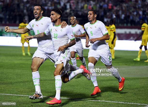 Carl Medjani of Algeria and teammates celebrate after Medjani scored the only goal of the game five minutes before the end of their Coupe D`Afrique...