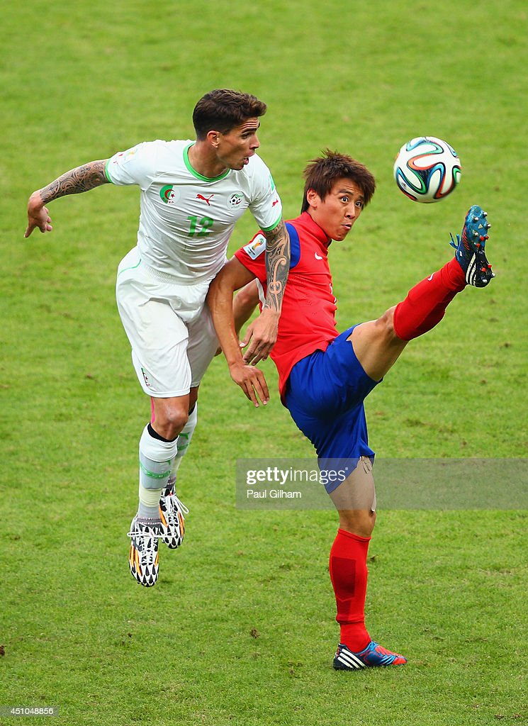 <a gi-track='captionPersonalityLinkClicked' href=/galleries/search?phrase=Carl+Medjani&family=editorial&specificpeople=622553 ng-click='$event.stopPropagation()'>Carl Medjani</a> of Algeria competes for the ball with <a gi-track='captionPersonalityLinkClicked' href=/galleries/search?phrase=Koo+Ja-Cheol&family=editorial&specificpeople=4894781 ng-click='$event.stopPropagation()'>Koo Ja-Cheol</a> of South Korea during the 2014 FIFA World Cup Brazil Group H match between South Korea and Algeria at Estadio Beira-Rio on June 22, 2014 in Porto Alegre, Brazil.