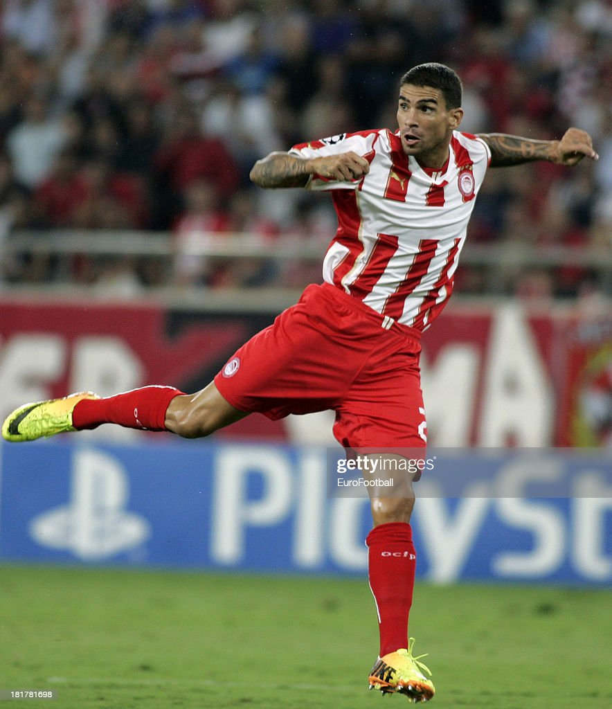 <a gi-track='captionPersonalityLinkClicked' href=/galleries/search?phrase=Carl+Medjani&family=editorial&specificpeople=622553 ng-click='$event.stopPropagation()'>Carl Medjani</a> of Olympiacos FC in action during the UEFA Champions League group stage match between Olympiacos FC and Paris Saint-Germain FC held on September 17, 2013 at the Georgios Karaiskakis Stadium in Athens, Greece.