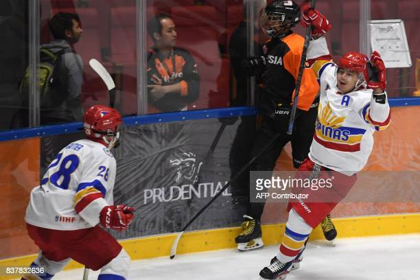Carl Michael Montano of the Philippines celebrate a goal during their round robin ice hockey game against Malaysia during the 29th Southeast Asian...