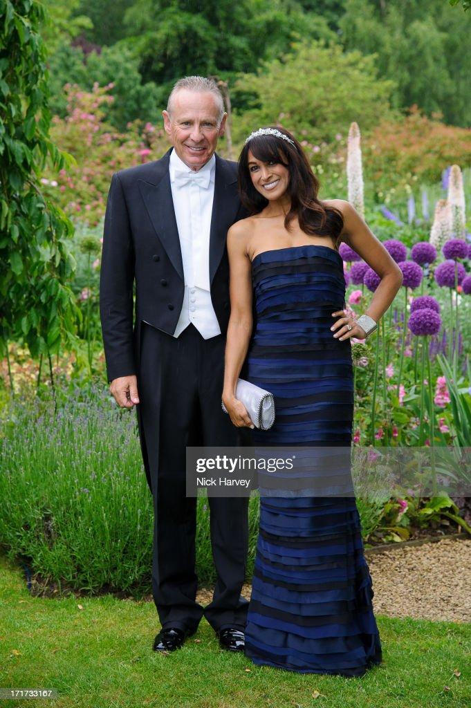 Carl Michaelson and Jackie St Clair attend the 15th Annual White Tie and Tiara Ball to Benefit Elton John AIDS Foundation in Association with Chopard at Woodside on June 27, 2013 in Windsor, England. No sales to online/digital media worldwide until the 14th of July. No sales before July 14th, 2013 in UK, Spain, Switzerland, Mexico, Dubai, Russia, Serbia, Bulgaria, Turkey, Argentina, Chile, Peru, Ecuador, Colombia, Venezuela, Puerto Rico, Dominican Republic, Greece, Canada, Thailand, Indonesia, Morocco, Malaysia, India, Pakistan, Nigeria. All pictures are for editorial use only and mention of 'Chopard' and 'The Elton John Aids Foundation' are compulsory. No sales ever to Ok, Now, Closer, Reveal, Heat, Look or Grazia magazines in the United Kingdom. No sales ever to any jewellers or watchmakers other than Chopard.